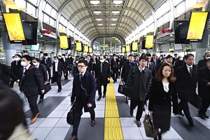 TL Crowded morning commute scene at JR Shinagawa Station Rainbow Road passageway.TL Crowded morning commute scene at JR Shinagawa Station Rainbow Road.